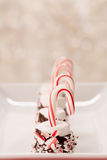 Christmas Candy Cane and Marshmallow Treats. Chocolate covered marshmallow Christmas treats with candy canes Stock Images
