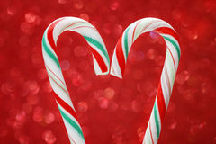 Christmas candy cane on red background Royalty Free Stock Photo