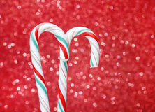 Christmas candy cane on red background Royalty Free Stock Photos