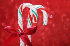 Christmas candy cane on red background Stock Photography