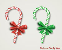Christmas Candy Cane with Red Bow Isolated on White Background. Royalty Free Stock Photo