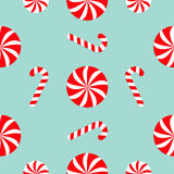 Christmas Candy Cane Round white and red sweet set. Seamless Pattern Decoration. Wrapping paper, textile template. Blue background. Flat design. Vector royalty free illustration