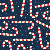 Christmas Candy Cane Seamless Pattern. A seamless Christmas pattern with red and white candy cane, isolated on blue background. Useful also as design element for Stock Photo