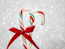 Christmas candy cane on silver background Stock Photo