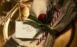 Thank You Card. Handwritten thank you place card in fancy golden Xmas table place setting with candy cane and crystal snowflake Royalty Free Stock Photo