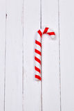 Christmas candy cane on white background wooden table Stock Images