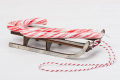 Christmas Candy Cane On Wooden Sledge. White Royalty Free Stock Photography