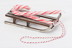 Christmas Candy Cane On Wooden Sledge. White Stock Photo