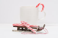 Christmas Candy Cane On Wooden Sledge. White Stock Images