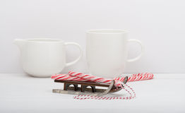 Christmas Candy Cane On Wooden Sledge. White Royalty Free Stock Image