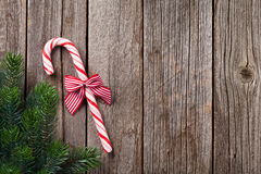 Christmas candy cane on wooden table Royalty Free Stock Photo