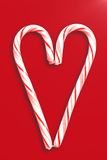 Christmas Candy Canes. Two candy canes on a dark red background Stock Image