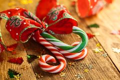 Christmas candy canes. With a gift ribbon on the wooden background Stock Photo