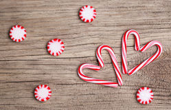 Christmas Candy Canes in Heart Shape and Peppermint Candy Stock Photos