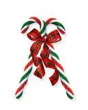 Christmas candy canes with ribbons Stock Images