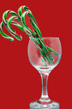 Christmas candy canes in a wine glass Stock Photos