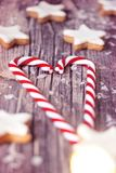 Christmas candy and cinnamon stars on wooden background stock photos