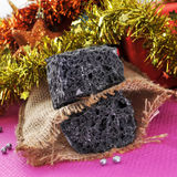 Christmas candy coal. Some lumps of candy coal and some christmas ornaments and gifts Stock Photos