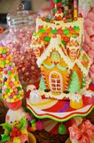 Christmas Candy Gingerbread House. A Christmas candy display with both edible and enedible treats stock photography