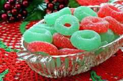 Christmas candy in glass dish on doily. Royalty Free Stock Photo