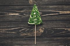 Christmas candy green tree flat lay. christmas tree lollipop on stock image