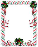 Christmas Candy and Holly border. Image and Illustration composition for Christmas holiday background, invitation or card with copy space or room for photo Royalty Free Stock Image