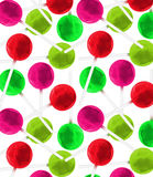 Christmas Candy lollipops seamless wallpaper on a white background. Christmas red green candy pops  in a seamless repeat pattern Stock Photography