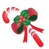Christmas candy with mistletoe Stock Photo