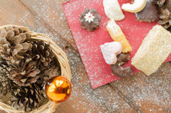 Christmas candy with pinecone in punnet Royalty Free Stock Photos