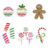 Christmas candy set. Vector illustration of Christmas candy set: lollipop, candy cane, cupcake, marshmallow, gingerbread man Royalty Free Stock Images