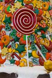 Christmas candy , snow , red lollipop and colored fruits royalty free stock photo