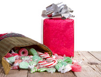 Christmas candy spilling out of a stocking Royalty Free Stock Photography