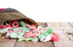 Christmas candy spilling out of a stocking Royalty Free Stock Photos