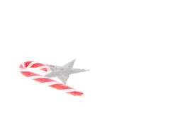 Christmas candy and star on white background Stock Images