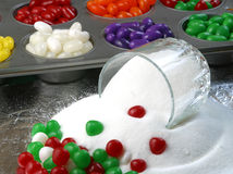 Christmas candy and sugar. Christmas candy and a bowl of spilled sugar royalty free stock images