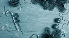 Christmas candy and treats on the table. Sweet gifts for childre. Christmas candy and treats on the table monochrome blue poster Royalty Free Stock Images
