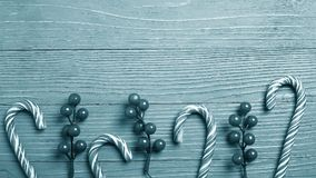 Christmas candy and treats on the table. Sweet gifts for childre. Christmas candy and treats on the table monochrome blue poster Royalty Free Stock Photos