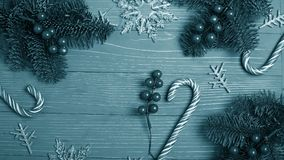 Christmas candy and treats on the table. Sweet gifts for childre. Christmas candy and treats on the table monochrome blue poster Stock Images