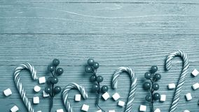 Christmas candy and treats on the table. Sweet gifts for childre. Christmas candy and treats on the table monochrome blue poster Royalty Free Stock Photography