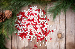 Christmas candy on wooden background Stock Photography