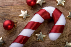 Christmas candycane. With red ribbon, gold star and red christmas balls Stock Photography