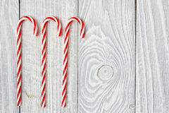 Christmas cane decoration on wooden background Stock Images