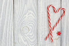 Christmas cane decoration on wooden background Royalty Free Stock Images