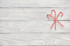 Christmas cane decoration on wooden background Stock Photography