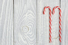 Christmas cane decoration on wooden background Stock Photos