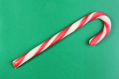 Christmas cane on green background Royalty Free Stock Photography