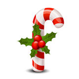 Christmas cane with red berries Stock Photo