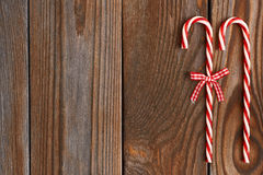 Christmas cane on wooden background Stock Photo