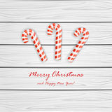 Christmas cane on wooden background Royalty Free Stock Image