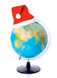 A christmas cap on the globe Stock Photography